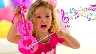 Milana and dad Pretend Play with Musical Instrument Toys